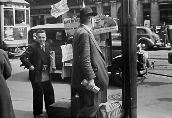 Newspaper vendor near the corner of Granville and Robson Street. Photo: James Crookall, City of Vancouver Archives CVA-260-1372