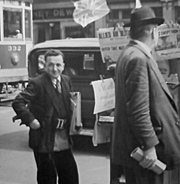 Detail of Photo - Newspaper vendor near the corner of Granville and Robson Street. Photo: James Crookall, City of Vancouver Archives CVA-260-1372