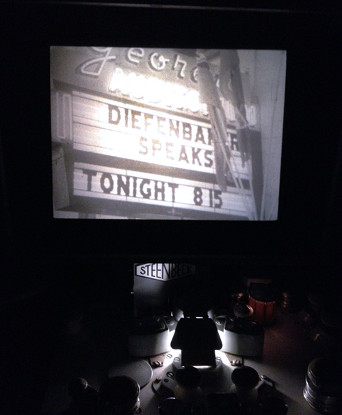 Image from CBUT news footage of Georgia Auditorium sign promoting the appearance of John Diefenbaker (1957) projected on the screen of a Steenbeck. Photo: C. Hagemoen