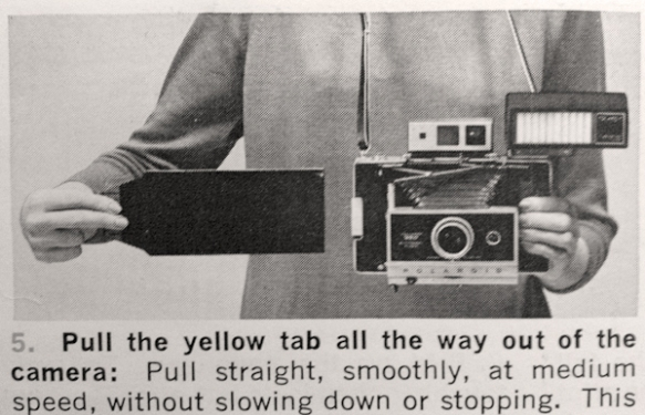 Image from Land Camera model 360 instruction manual - removing film from camera. Photo: C. Hagemoen