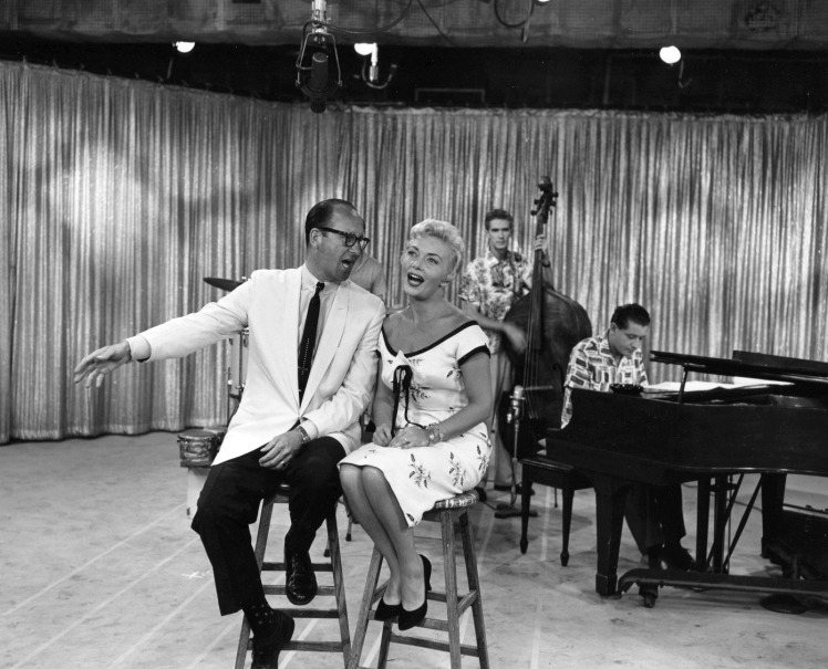 """Dal Richards and Lorraine MacAllister with the Chris Gage Trio on CBUT's """"Meet Lorraine"""" ca. 1958. Photo: Alvin Armstrong, CBC Vancouver Still Photo Collection"""