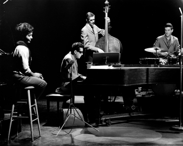 "Eleanor Collins with the Chris Gage (Piano) Trio -  Stan ""Cuddles"" Johnson on bass, and Jimmy Wightman on drums, CBUT-TV studios. Photo: Alvin Armstrong, CBC Vancouver Still Photo Collection"