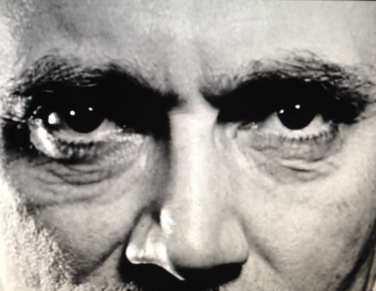 Screen still of John Grierson's infamous penetrating gaze from the NFB film Grierson.