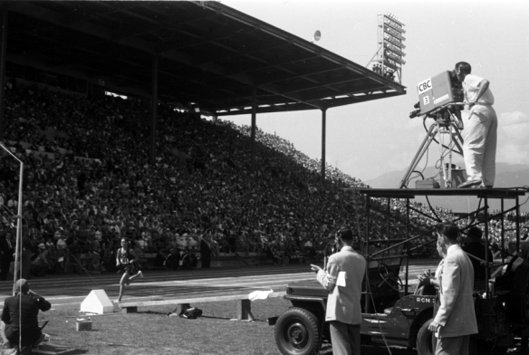 """CBC """"electronic"""" television camera mounted atop a jeep at Empire Stadium covers the Track and Field action, August 7th 1954. Photo: Alvin Armstrong, CBC Vancouver Still Photo Collection."""