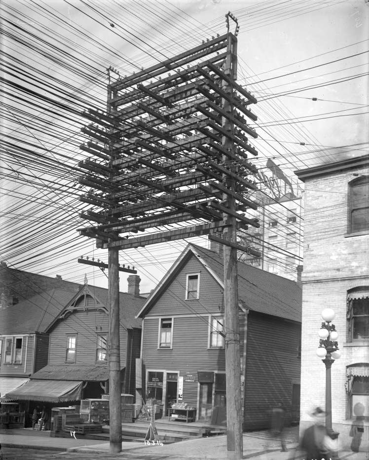 Power lines and supporting structure in lane west of Main Street at Pender Street. March 10 , 1914. Photo: British Columbia Electric Railway Company, CoV Archives, AM54-S4-: LGN 1241,